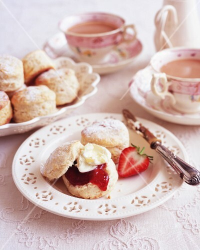 Scones with clotted cream and strawberry jam served with tea