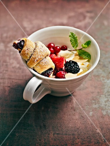 Potato & blackberry pastries on fresh wild berries