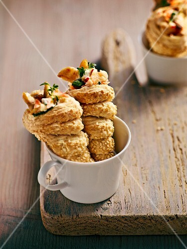 Spiral-shaped puff pastries filled with carrot & chicken salad and coated in sesame seeds