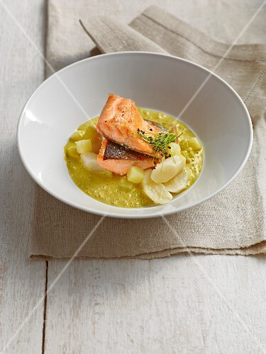 Pan-fried salmon trout on a bed of black salsify & potato curry