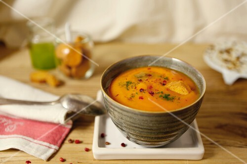 Creamy pumpkin & sweet potato soup with red pepper, croutons and wasabi powder
