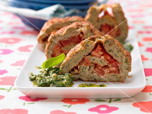 Spicy sponge roulade with tomatoes and pesto