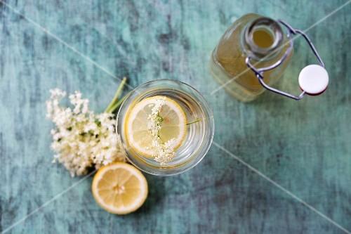 An elderflower drink and elderflower syrup in a bottle