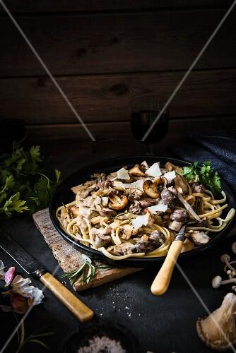Tagliatelle with creamy garlic, herb & mushroom sauce and Parmesan cheese shavings.