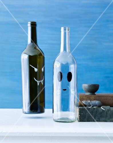 Halloween bottles decorated with scary faces