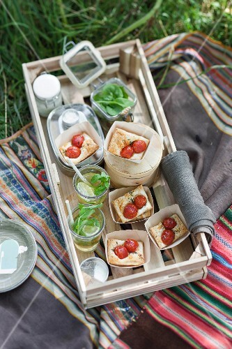 Tomato tartlets in paper cases for a picnic served with lime iced tea