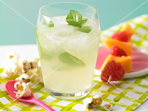 Melon punch with a fruit kebab