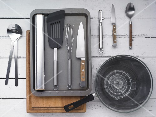 Kitchen utensils for preparing seared duck breast with salad