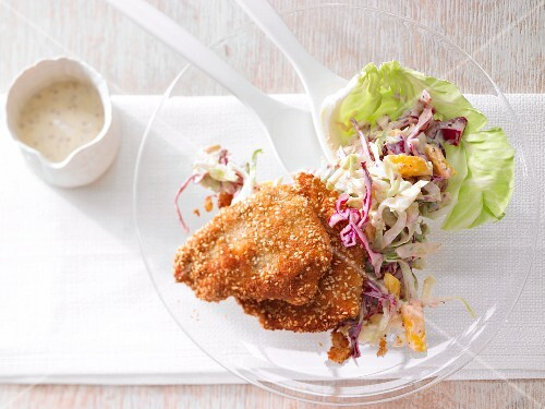 Mini escalopes with a sesame seed coating served with mango & cabbage salad