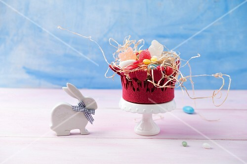 An Easter basket with jelly egg sweets, sugar-coated eggs and foam eggs