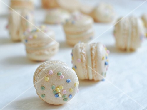 Macarons with a white chocolate & cinnamon filling topped with sprinkles