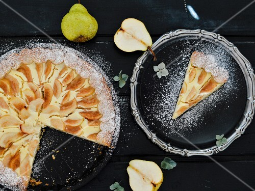 Sliced pear & cream cheese cake dusted with icing sugar