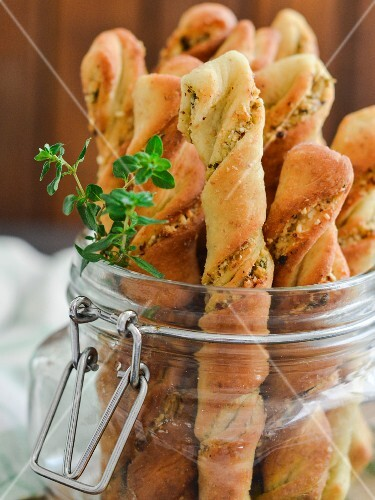 Twisted doughsticks with herbs and toasted hazelnuts