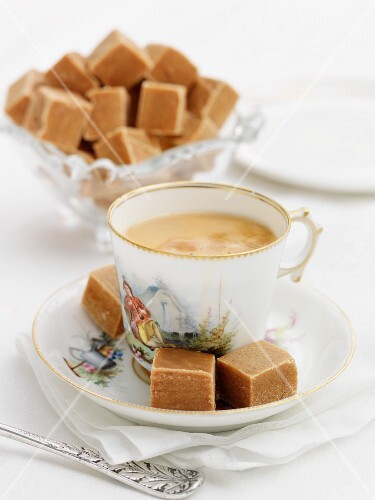 Cubes of fudge served with tea