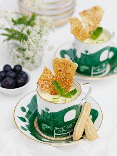 Lime & lemon posset with mini shortbread fingers and shards of sesame seed brittle