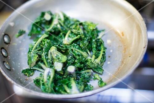 Leaf vegetables in a frying pan