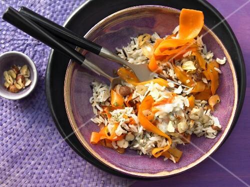 Fried carrot rice with hazelnuts and gorgonzola
