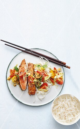 Salmon teriyaki with a cherry tomato, spring onion and rice noodle salad