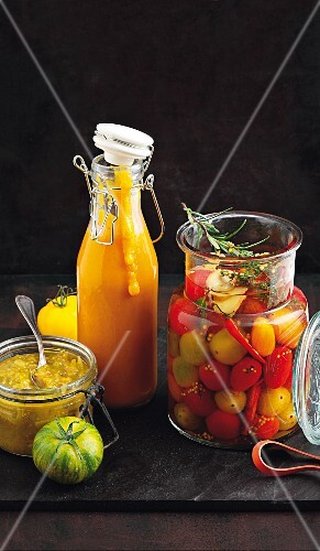 Tomato ketchup, sweet and sour pickled cherry tomatoes and tomato relish