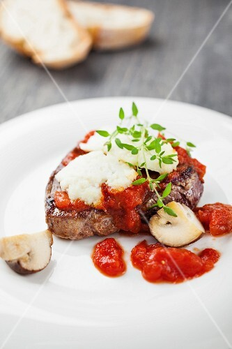 Beefsteak with goat's cheese, mushrooms and tomato sauce