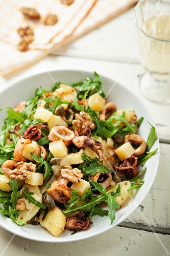 Squid salad with potatoes, rocket and walnuts