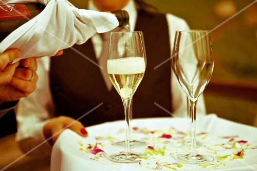 A waiter serving champagne at a restaurant