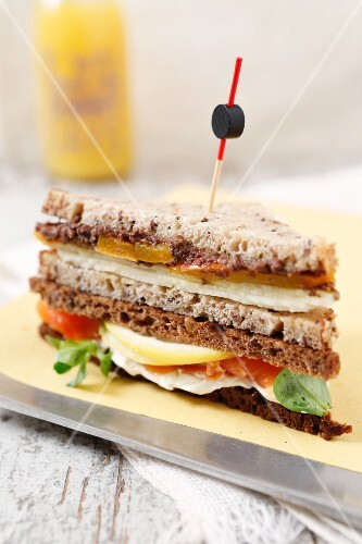 A sandwich made from dark and light bread
