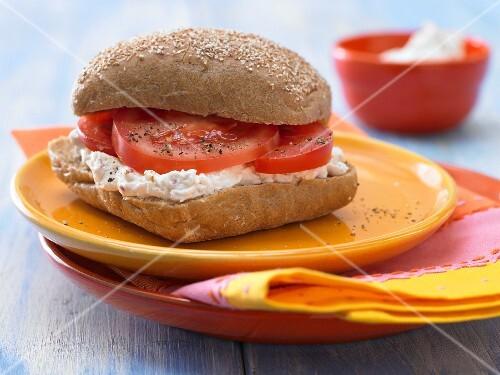 A savoury quark & cream cheese bread roll with tomato