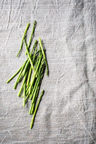 Green asparagus spears on a grey surface