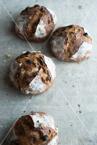 Loaves of crusty bread made from chestnut flour with raisins and hazelnuts