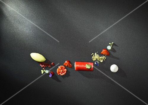 A selection of strawberry desserts on a black surface
