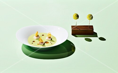 Green gazpacho on a coloured surface