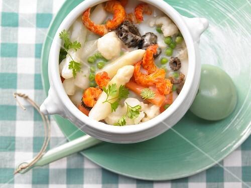 Leipziger Allerlei (regional German vegetable dish consisting of peas, carrots, asparagus, and morel mushrooms) with crab meat
