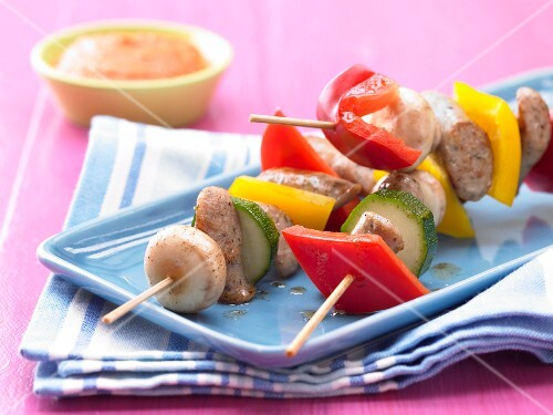 Sausage kebabs with courgette, peppers and mushrooms