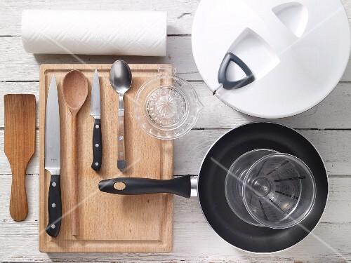 Assorted kitchen utensils for preparing salad