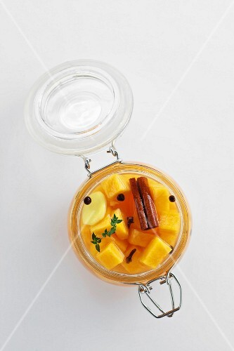 Pickled Muscade de Provence pumpkin with spices in a flip-top jar (seen from above)