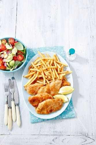 Chicken escalope with chips and salad
