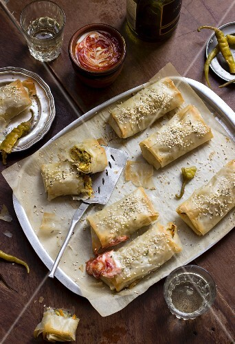 Moroccan pastillas (filo pastry filled with courgette, carrot, couscous and spices), served with harissa mixed with yoghurt