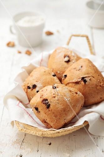 Walnut & raisin bread rolls in a bread basket