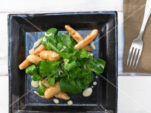 Baked black salsify with lamb's lettuce