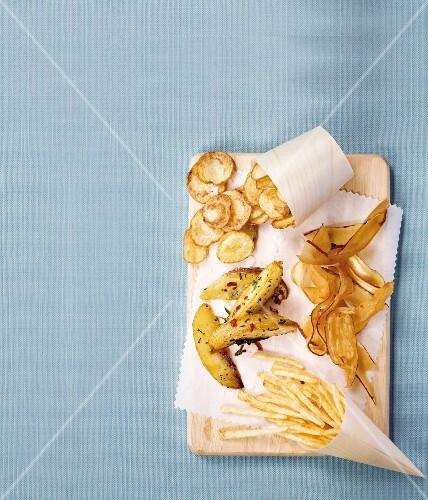 Potato crisps, potato wedges, low-fat root vegetable crisps, fried potatoes and chips