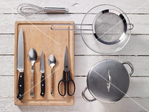 Kitchen utensils for preparing herring and green bean salad