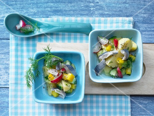 Potato and herring salad with yellow pepper, radish and a dill and mustard dressing