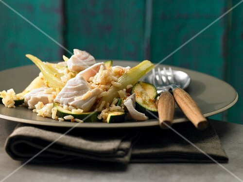 Fish and vegetable stew with fennel, courgette and rice