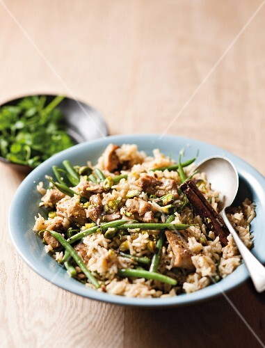 Chicken pilaf with cinnamon, pickled lemons and green beans