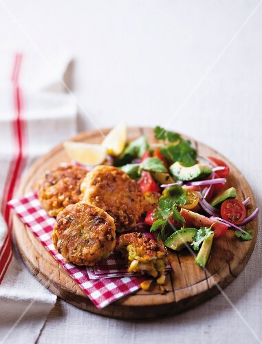 Fish cakes with sweetcorn and vegetable salad