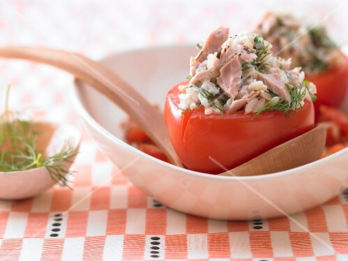 Stewed tomatoes filled with tuna, rice and herbs