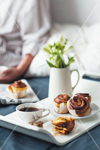 Breakfast in bed with pumpkin & cinnamon pastries and coffee
