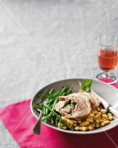 Saddle of lamb with white and green beans