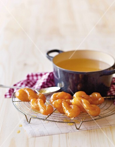 Home-made koeksister doughnuts with syrup